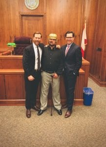 Client Zachary Lucas with Alexander Shunnarah Personal Injury Attorneys Brandon Bishop and Andrew Moak. Image courtesy of Shunnarah Personal Injury Attorneys, P.C.