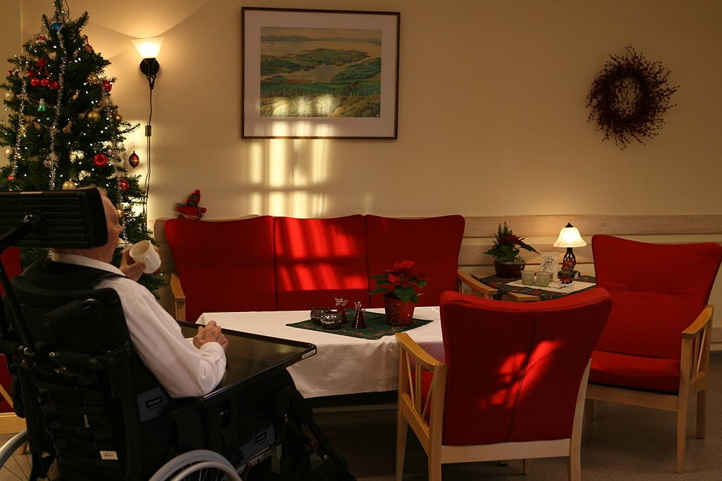 Elderly Man Sitting in a Nursing Home