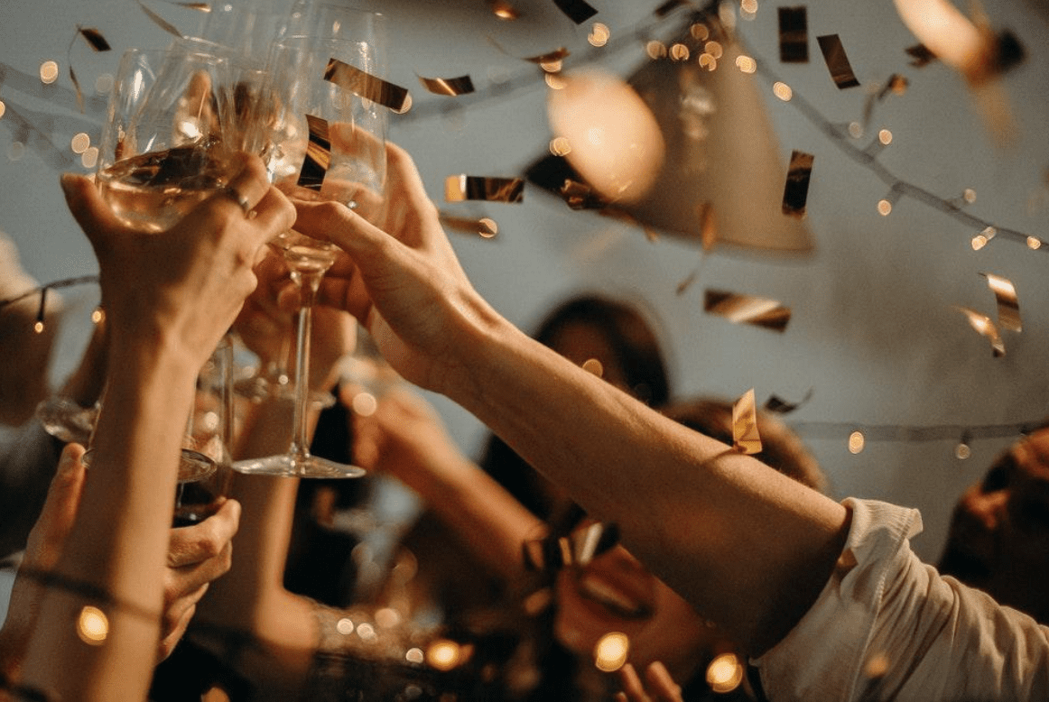 People toasting with glasses of wine; image by CottonBro, via Pexels.com.