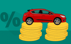 Graphic depicting the percent sign next to a red car that is resting on two stacks of gold coins; image by Mohamed Hassan, via Pixabay.com.