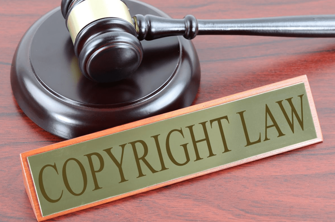 Copyright Law sign next to gavel; image by Nick Youngson, CC BY-SA 3.0, no changes, Alpha Stock Images.