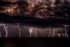 Thunderstorm with dark clouds; image by Josep Castells, via Unsplash.com.
