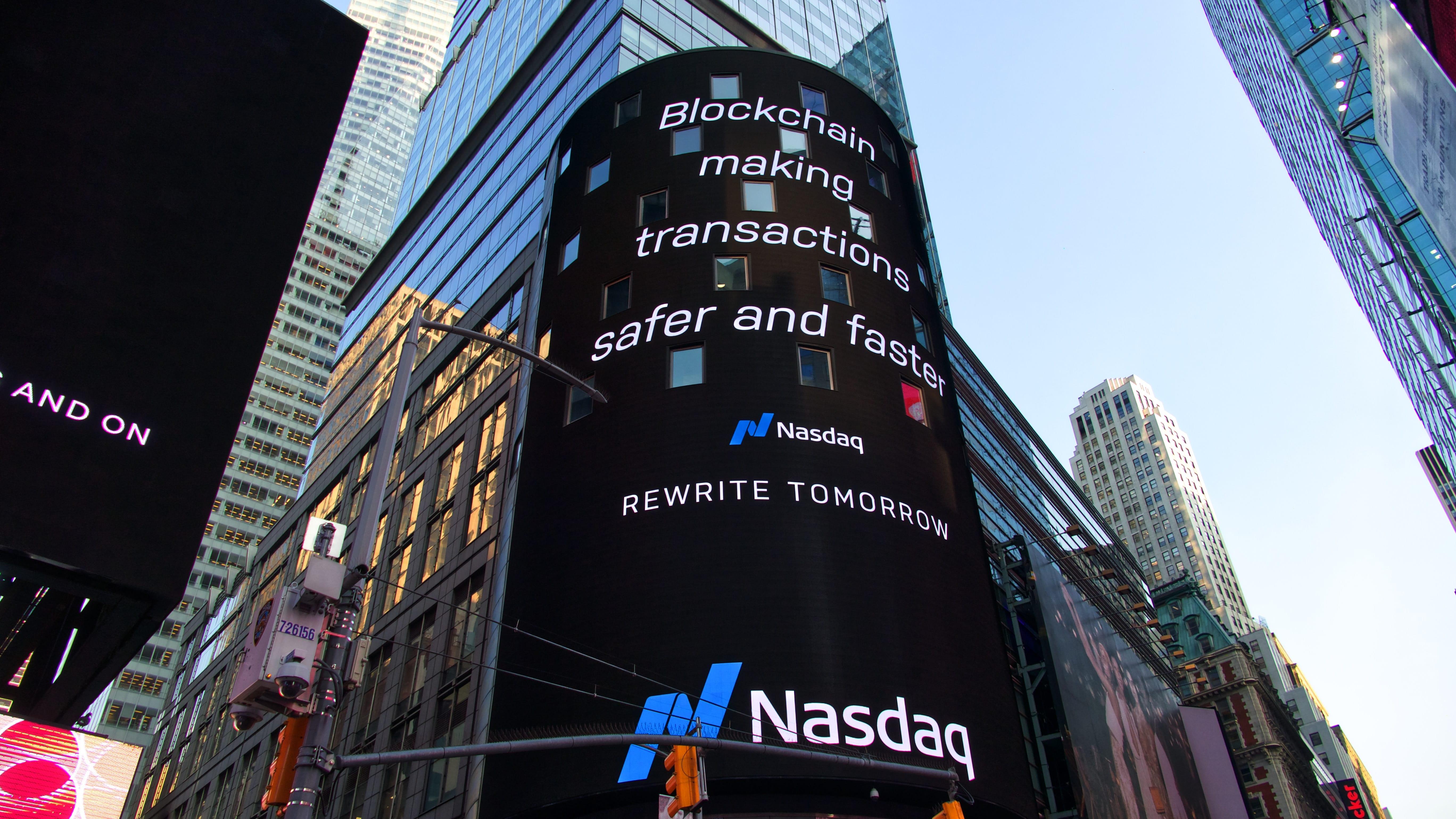 "Blockchain billboard in Times Square, New York City, saying ""Blockchain making transactions safer and faster. Nasdaq."" Image by Pascal Bernardon, via Unsplash.com."