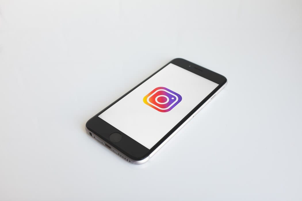 Smartphone with Instagram logo on screen; image by NeONBRAND, via Unsplash.com.