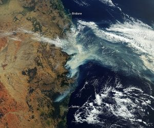 Satellite imagery of wildfire smoke curling up and away from the eastern coast of Australia.
