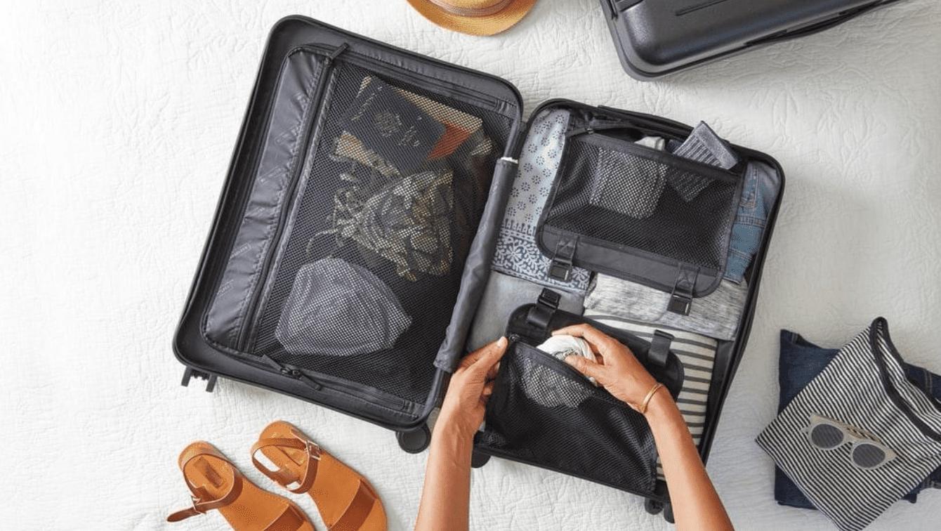 Packing a suitcase; image via Unsplash.com.