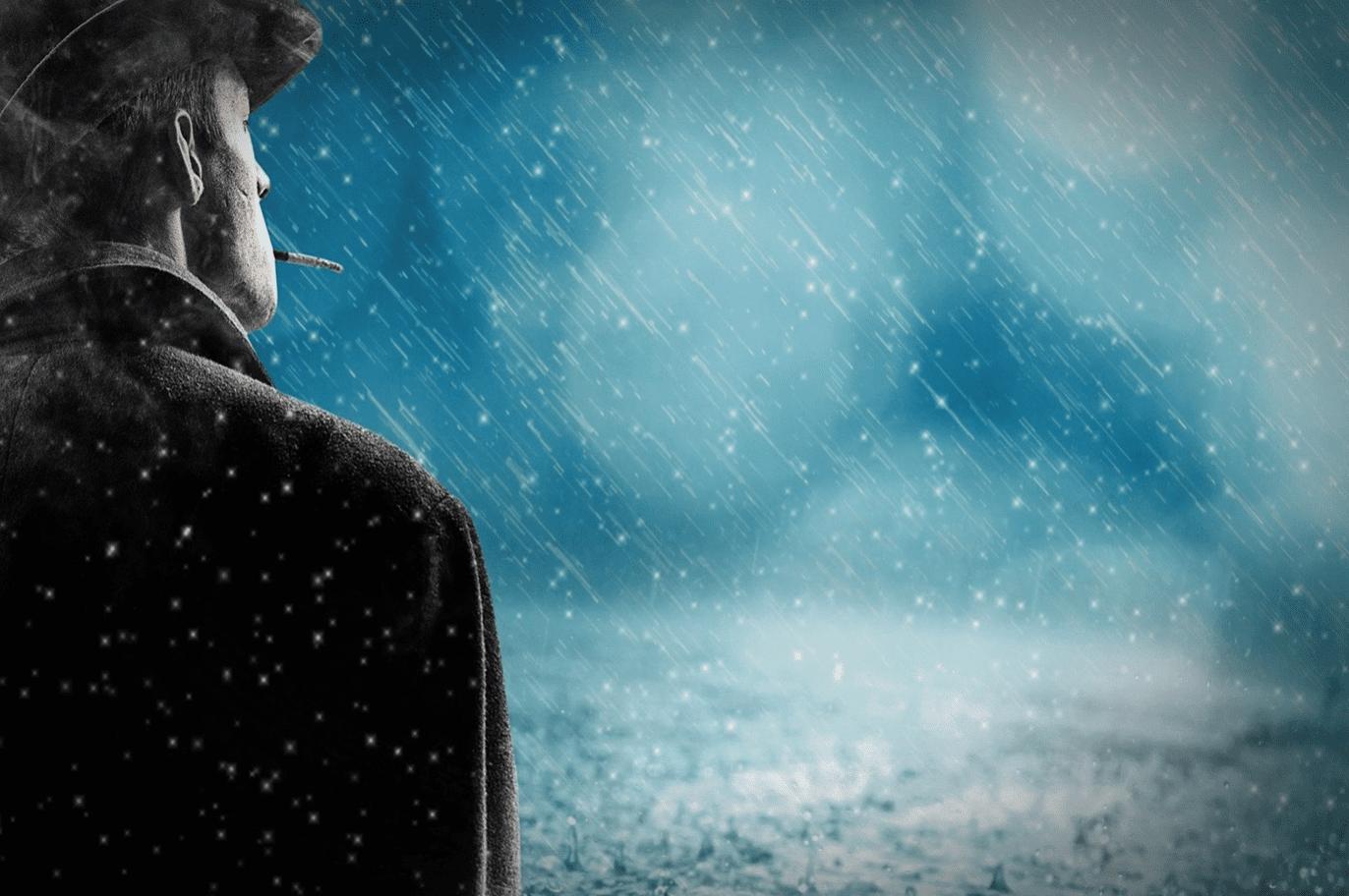 Man standing smoking a cigarette as snow falls; image by Pixel2013, via Pixabay.com.