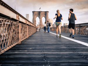 Joggers on the Brooklyn Bridge in New York City; image by Curtis MacNewton, via Unsplash.com.