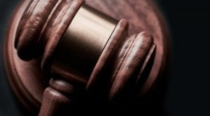 Closeup shot of gavel; image by Bill Oxford, via Unsplash.com.