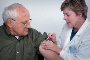 Doctor administering injection to patient; image by CDC, via Unsplash.com.