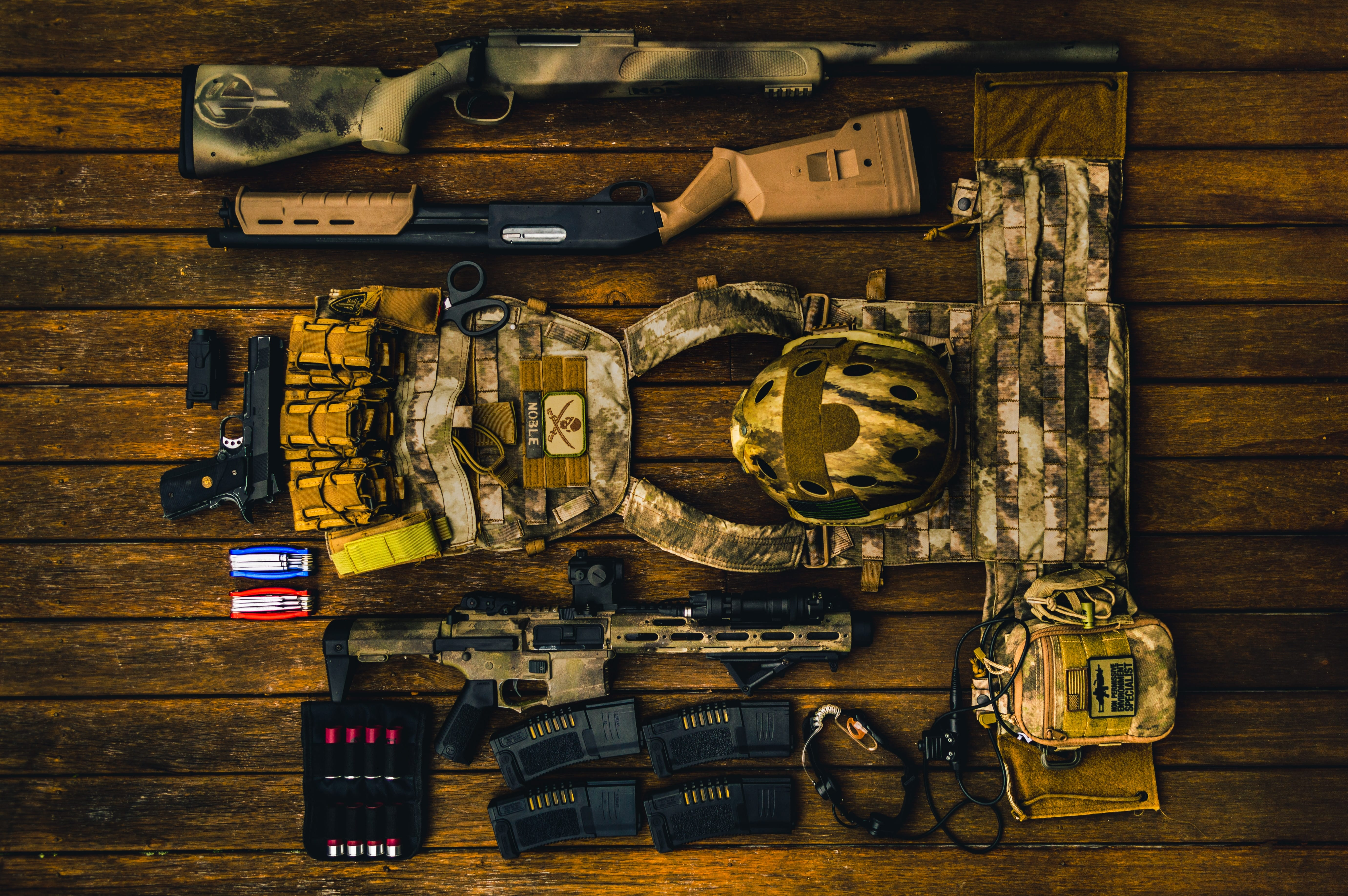 Brown and beige army gear set on brown surface; image by CMDR Shane, via Unsplash.com.
