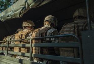 Soldiers in truck; image by Diego González, via Unsplash.com.