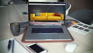 Laptop on table showing furniture product line; image by Igor Miske, via Unsplash.com.