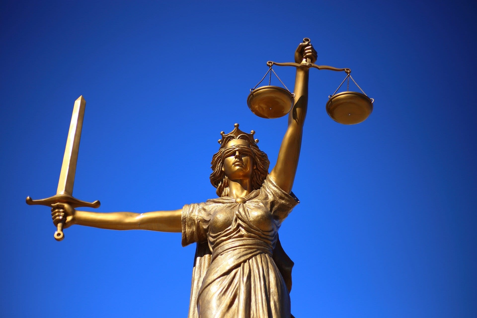 Statue of Lady Justice; image by William Cho, via Pixabay.com.