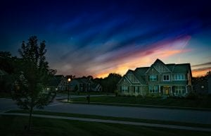 Grey wooden house at sunset; image by Kent Rebman, via Unsplash.com.