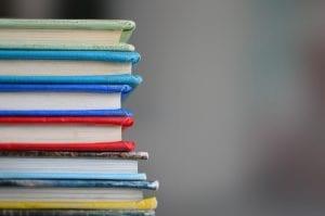 Stack of books; image by Kimberly Farmer, via Unsplash.com.