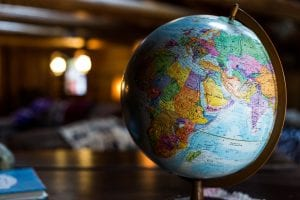 Desk globe on table; image by Kyle Glenn, via Unsplash.com.
