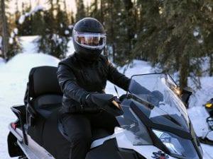 Snowmobile rider; image by Quihai Gao, via Unsplash.com.
