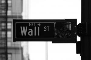 Grayscale photo of Wall St. signage; image by Rick Tap, via Unsplash.com.