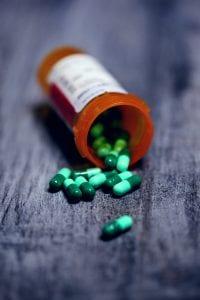 Shallow focus photography of prescription bottle with capsules; image by Sharon McCutcheon, via Unsplash.com.