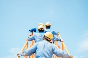 Workers on a ladder; image by Sol, via Unsplash.com.
