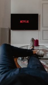 Man watching Netflix; image by Thibault Penin, via Unsplash.com.