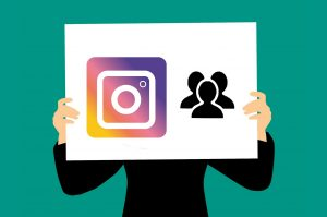 Graphic of man holding sign with Instagram icon and followers; image by Mohamed Hassan, via pixabay.com, CC0.