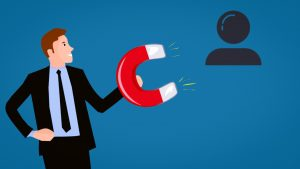 Graphic showing man in suit with large magnet attracting a follower icon; graphic by Mohamed_Hassan, via Pixabay.com.