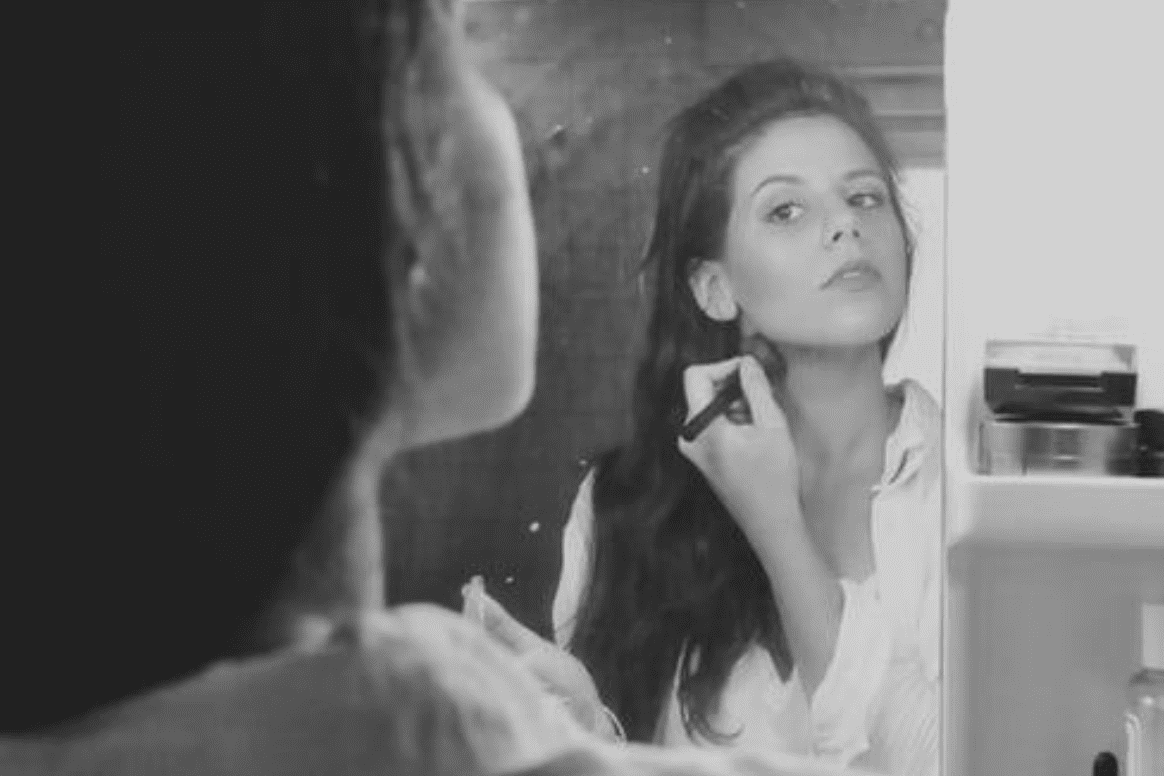 Woman applying makeup; image by Priscilla Du Preez, via Unsplash.com.