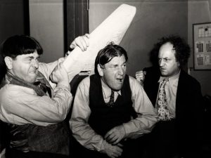 Black and white image of the Three Stooges goofing off in 1947.