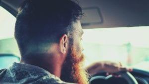 Bearded man driving; image by Abdiel Ibarra, via Unsplash.com.