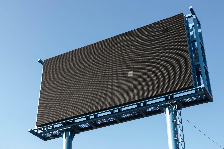 Electronic billboard that's been turned off; image by Paweł Czerwiński, via Unsplash.com.