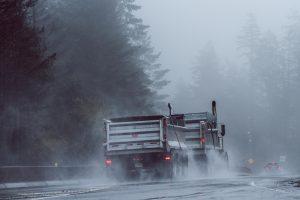 Gravel hauler on the road in the rain; image by Vlad Vasnetsov, via Unsplash.com.