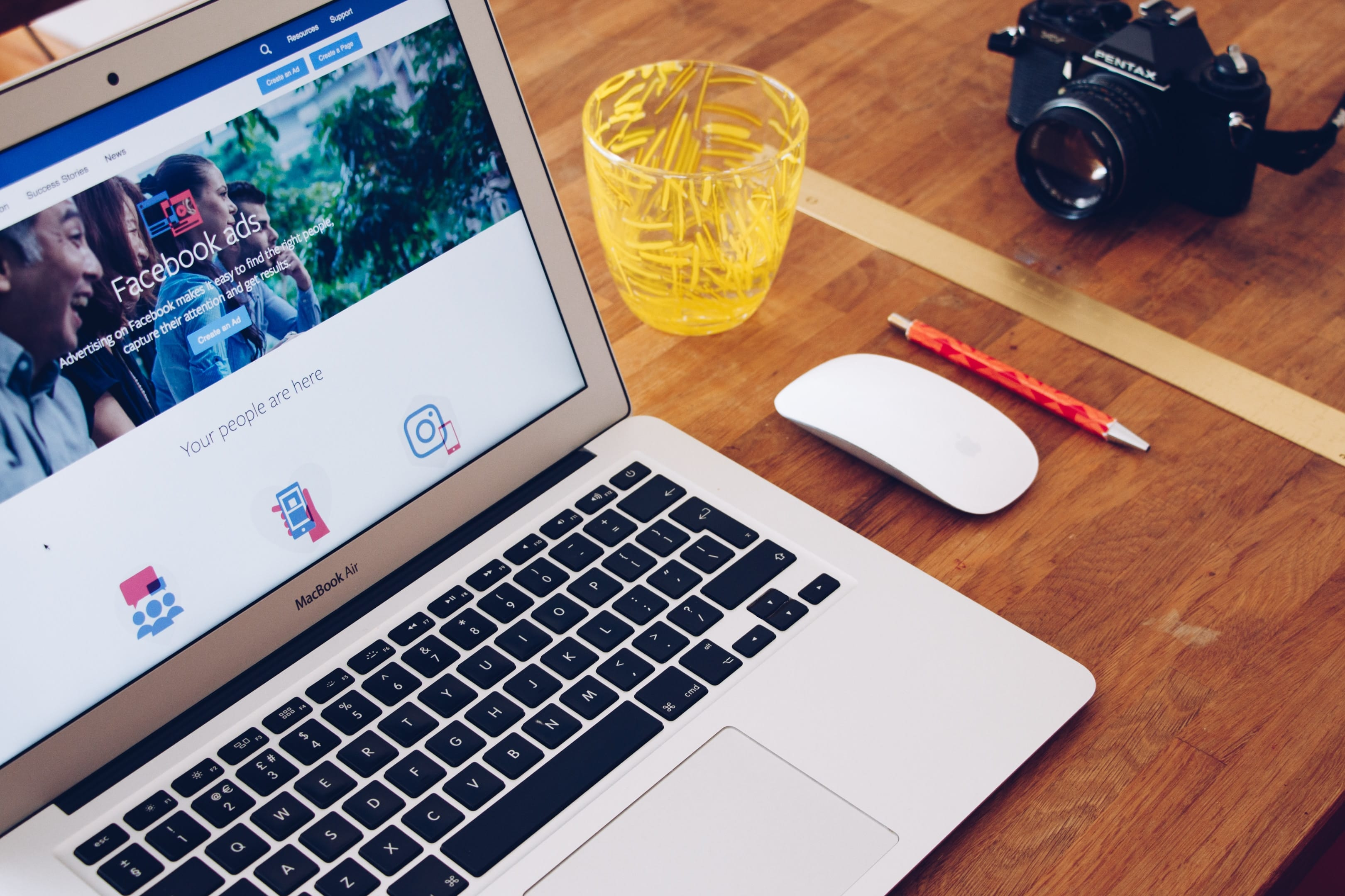 MacBook Air on table, Facebook open onscreen; image by Will Francis, via Unsplash.com.