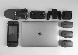 MacBook Pro near black Nintendo Switch, and game controller set; image by Willian Justen de Vasconcellos, via Unsplash.com.