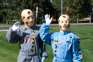 PETERSON AIR FORCE BASE, Colo. -- Crash test dummies Vince and Larry (Katelyn Smith, in the gray suit and Rae Reeves in the blue suit),(U.S. Air Force photo/Craig Denton).