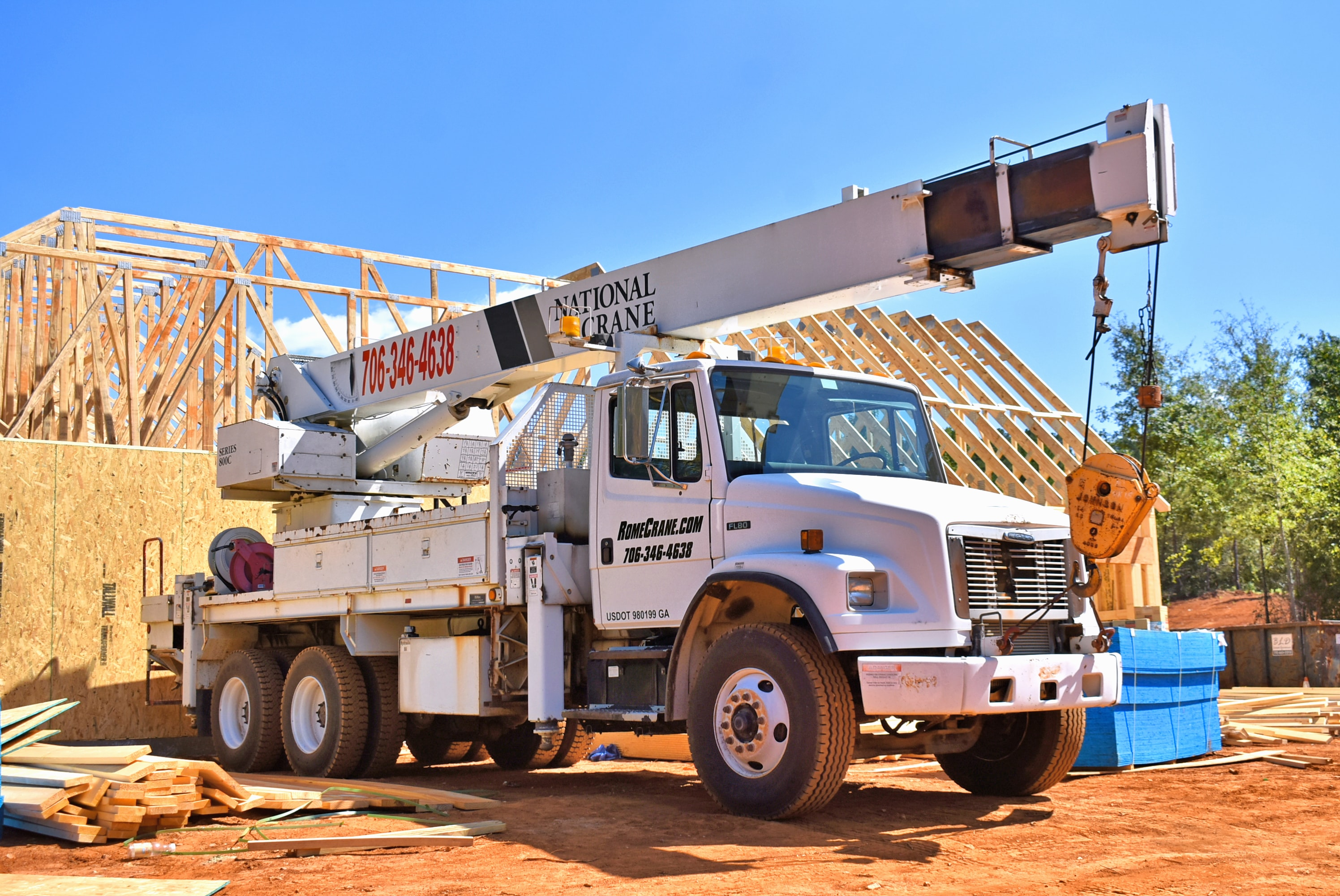 Crane truck at site of home renovation; image by Chris Boyd, via Unsplash.com.