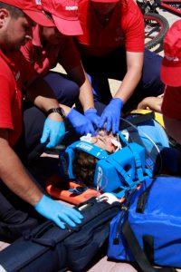 People performing first aid on an injured man; image by Daniela Santos, via Unsplash.com.