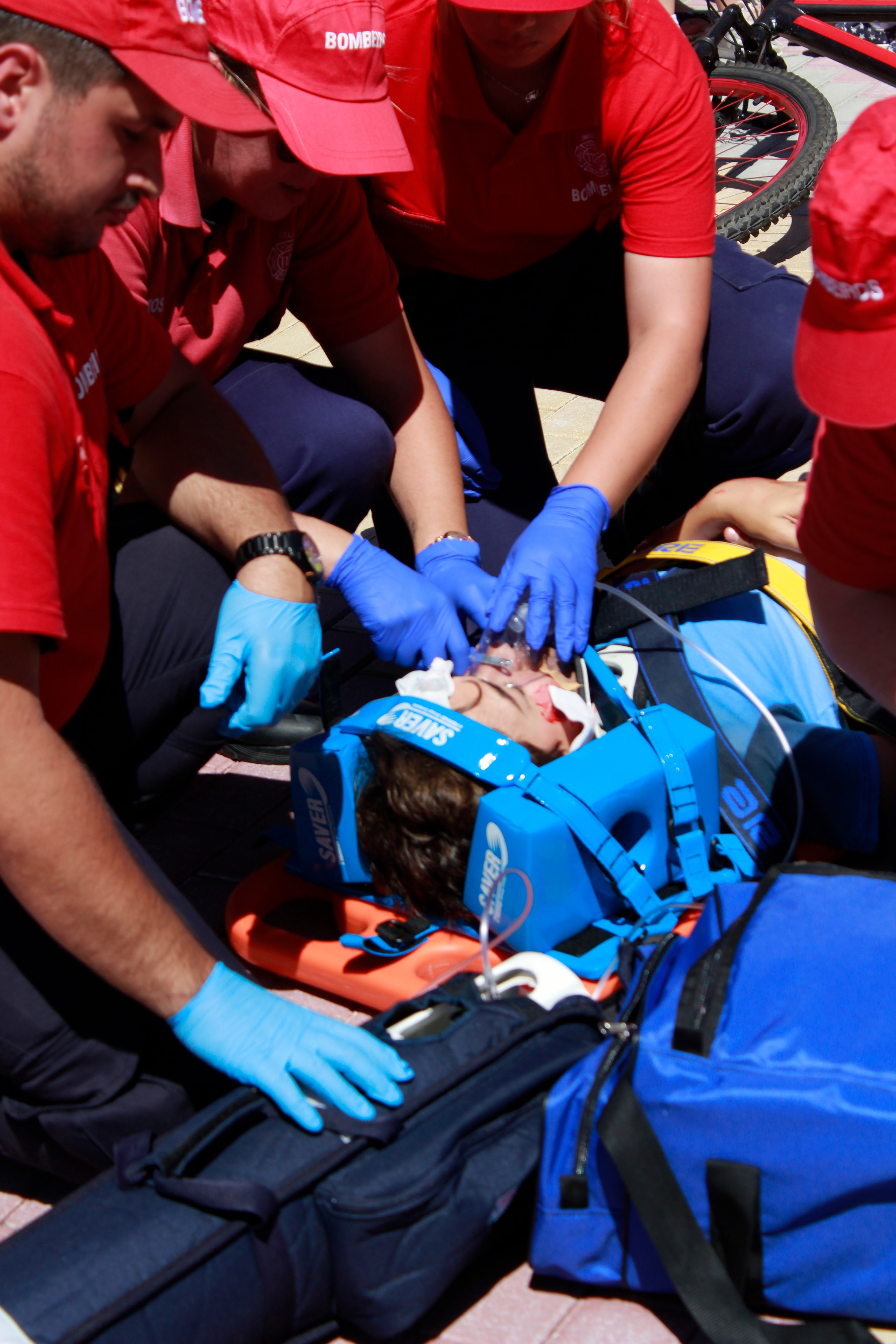 People performing first aid on an injured man; image by Daniela Santos, via Unsplash.com.