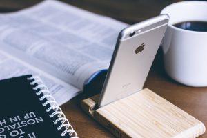 Silver iPhone 6 on rack; image by Freestocks, via Unsplash.com.