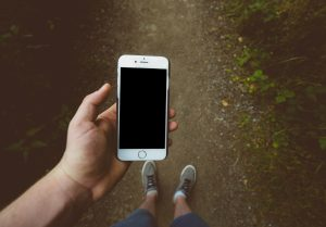 Person holding silver iPhone 6 with black case; image by Jamie Street, via Unsplash.com.