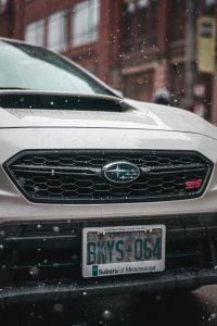 Silver car and license plate; image by Juan Rojas, via Unsplash.com.