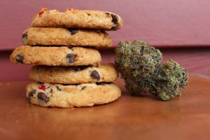Marijuana cookies with a marijuana flower; image by Margo Amala, via Unsplash.com.