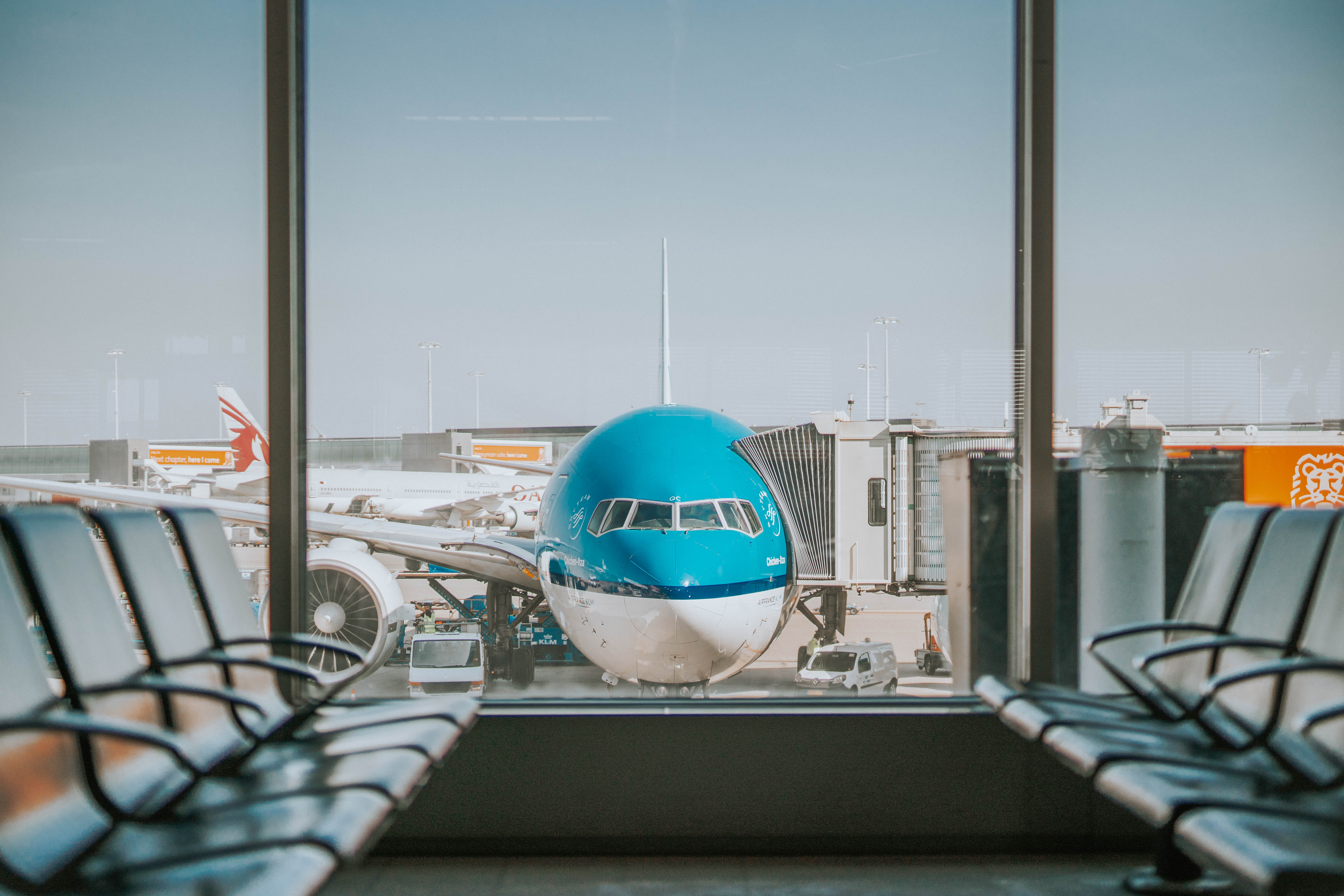 Airplane at empty gate; image by Oskar Kadaksoo, via Unsplash.com.