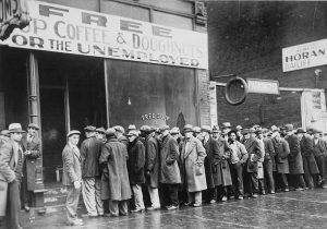 Vintage image of unemployed men standing in line for free soup, coffee, and doughnuts.