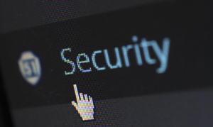 "Upclose shot of computer screen with the word ""Security"" and a hand-shaped cursor; image by Pixabay, via Pexels.com."