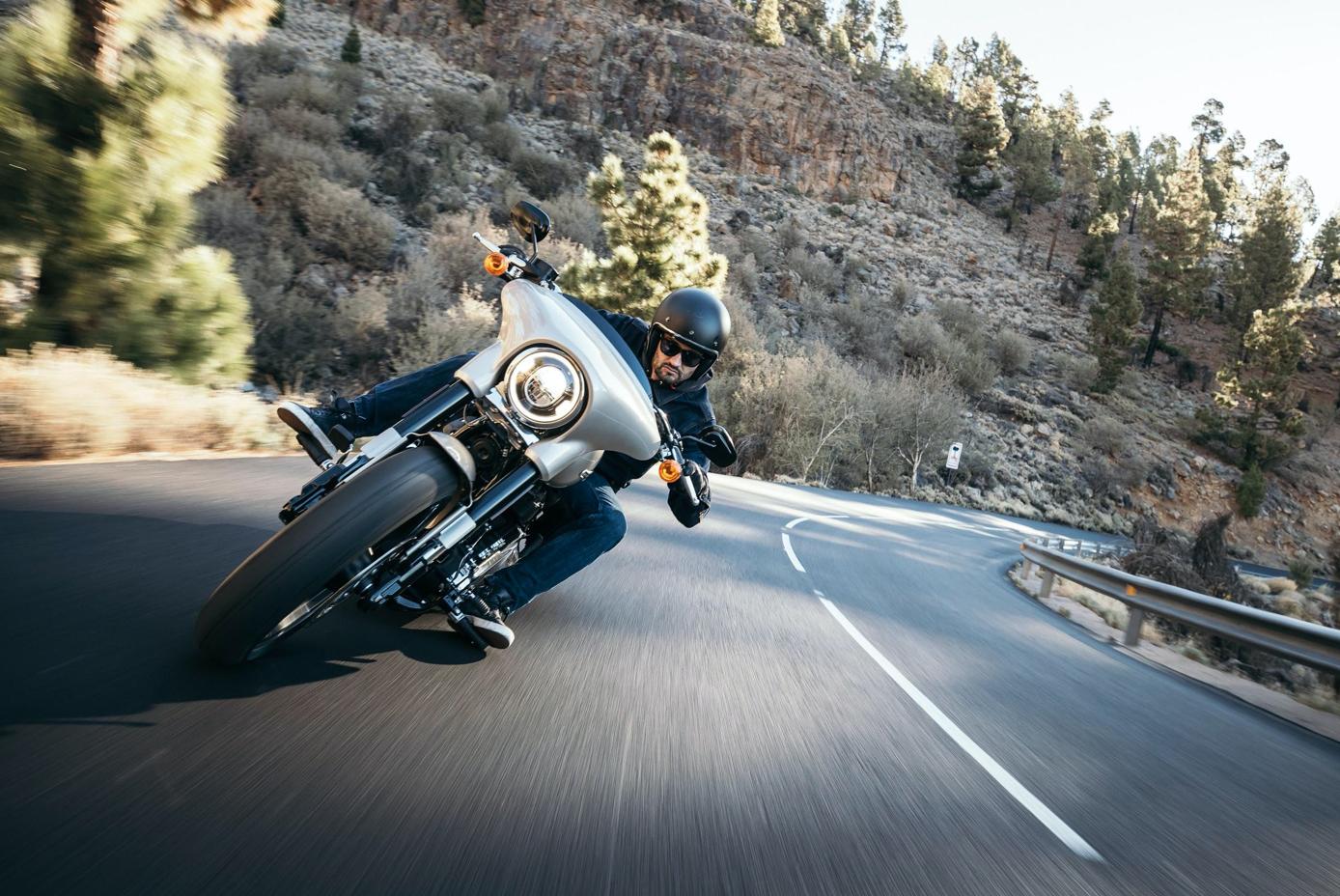 Man taking curve on a motorcycle; image by Harley-Davidson, via Unsplash.com.