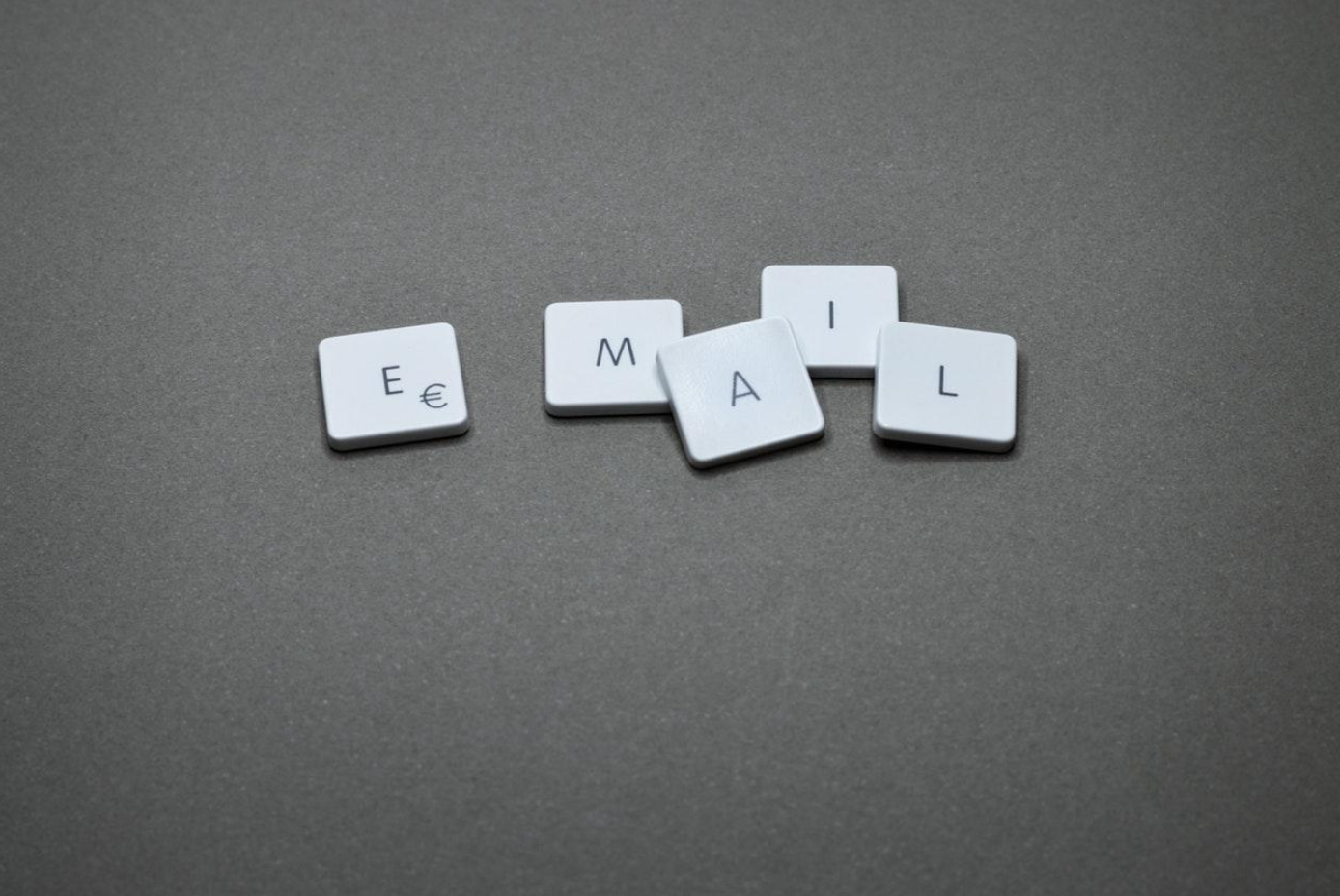 """""""Email"""" spelled in tiles on a gray surface; image by Miguel Á. Padriñán, via Pexels.com."""