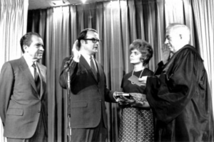 The first EPA Administrator, William D. Ruckelshaus, being sworn in with President Nixon behind him. Image via EPA.gov, public domain.