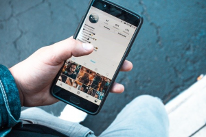 Man using Instagram on a smartphone; image by Erik Lucatero, via Unsplash.com.